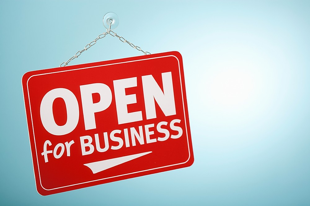 Open for Business sign in red on blue backgroud